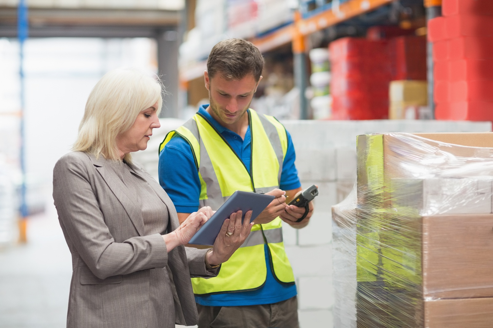 manager and employee in a warehouse