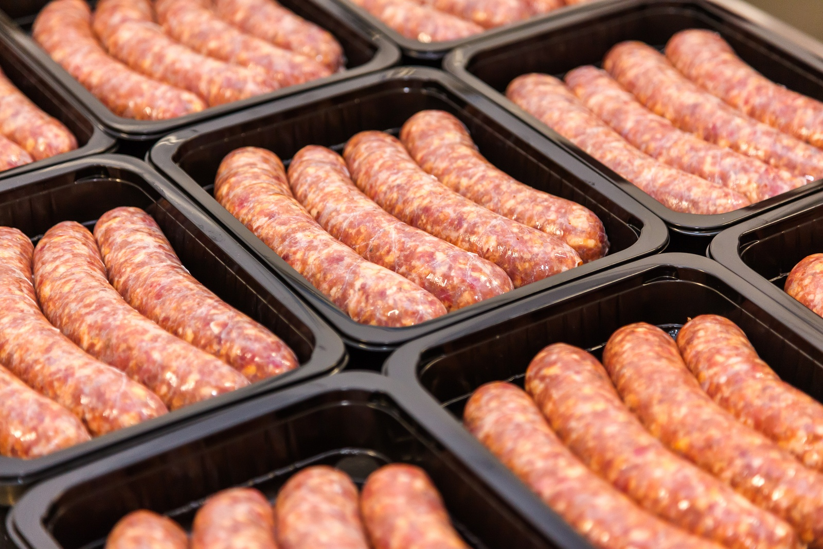 Bigstock  125354305 - Raw Meat Sausages In Packing Box