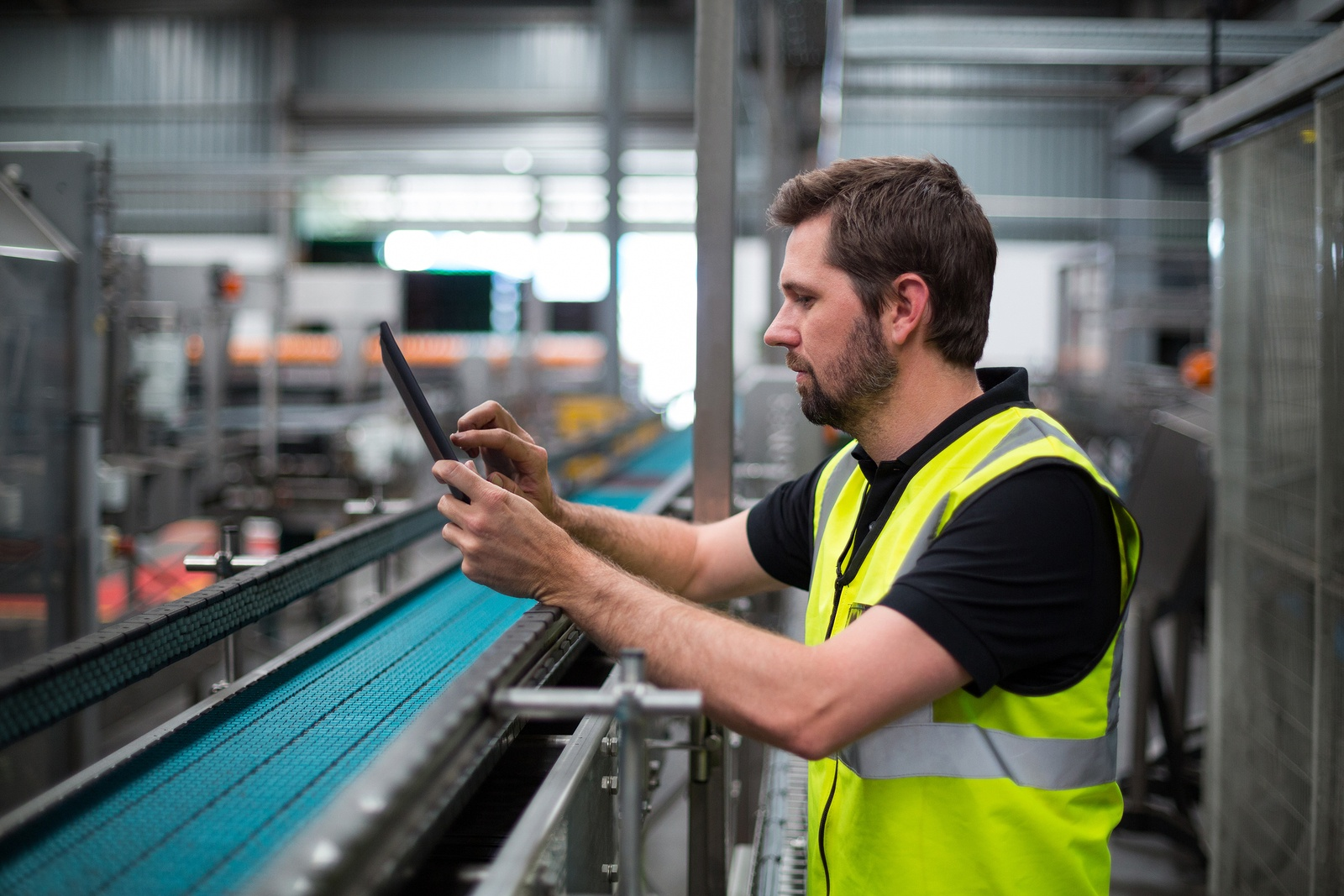 factory worker on a tablet