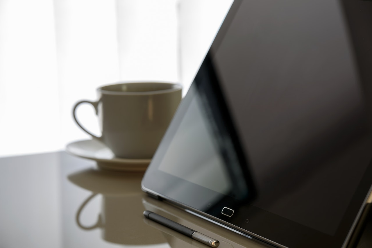 tablet and coffee cup