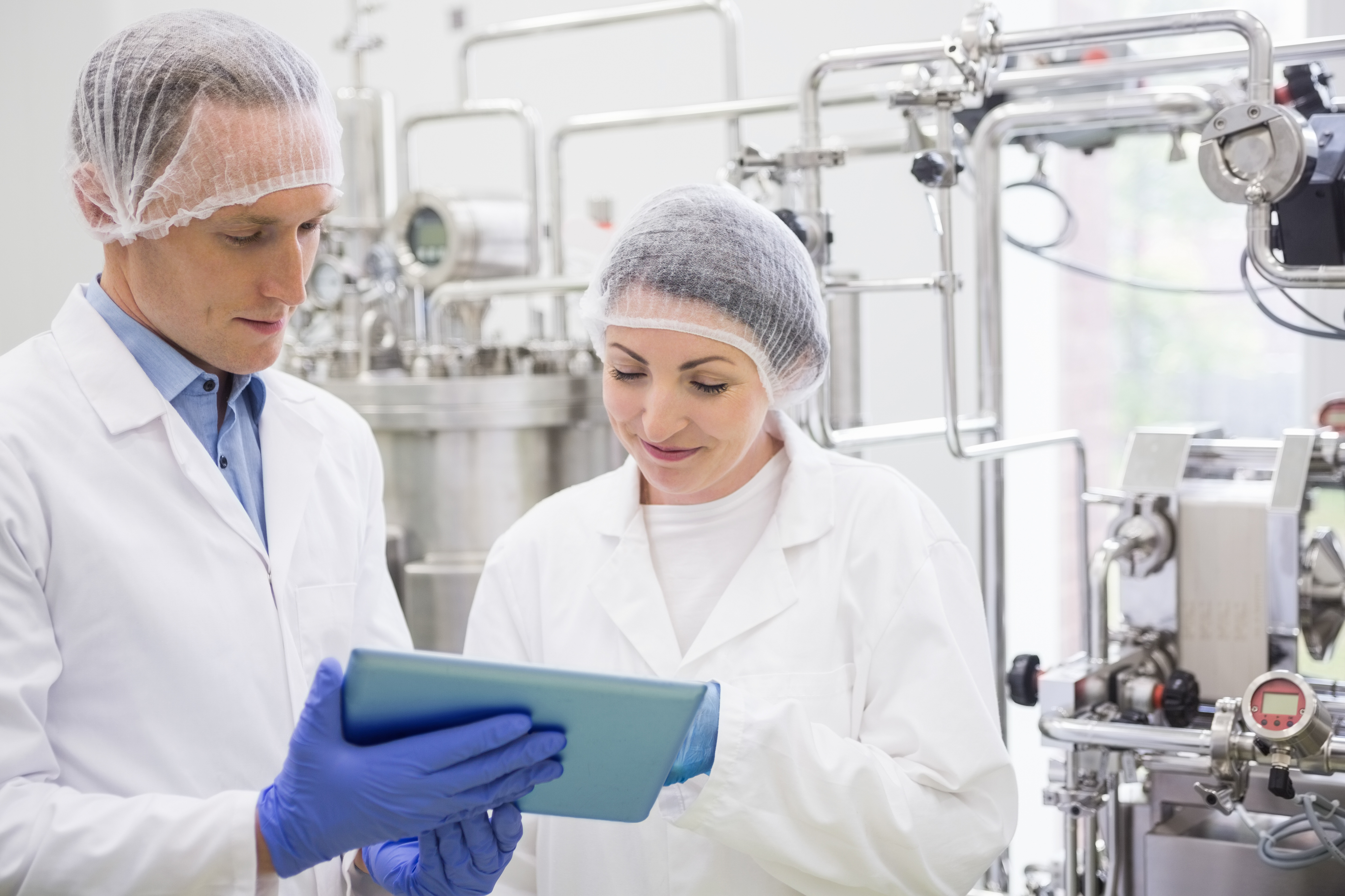 manufacturing plant workers with mobile tablet