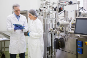 two people in a food factory