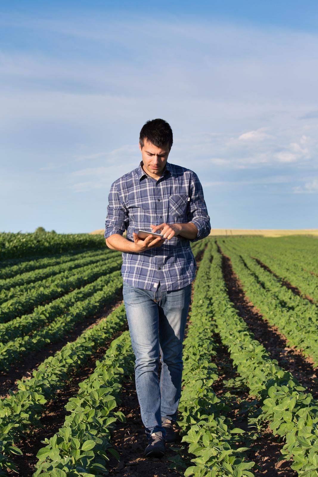 farmer on a tablet outside