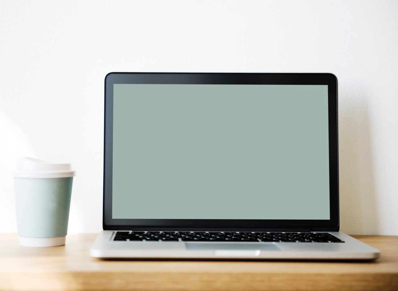 laptop and a cup of coffee